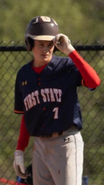 boy with batting helmet on