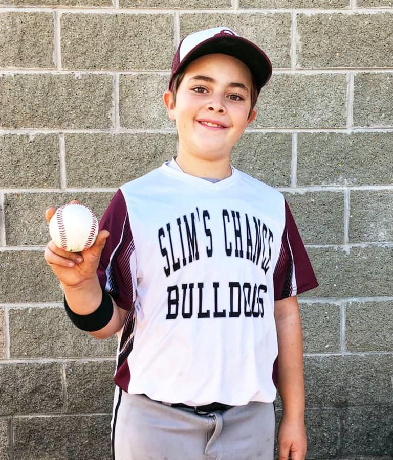 boy in jersey holding baseball