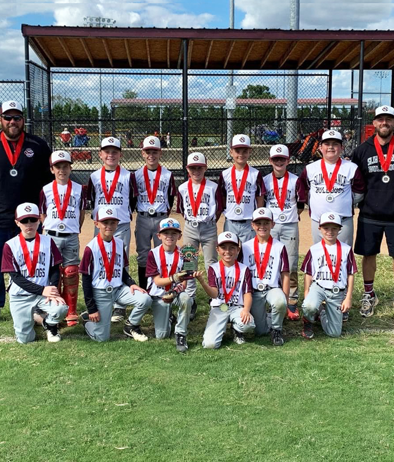 baseball team photo with medals