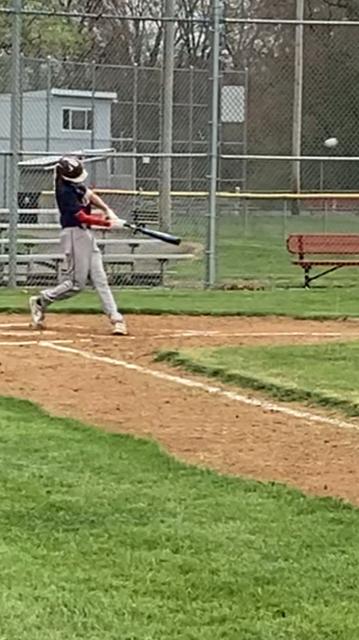 boy hitting on baseball field